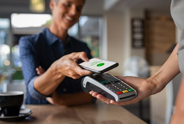 Woman paying using contactless card - Cash Flow Small Business